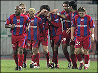 Panionios players celebrate a goal