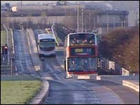 Two buses using the busway