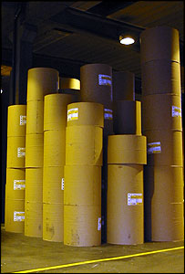 Giant rolls of paper wait to leave the mill