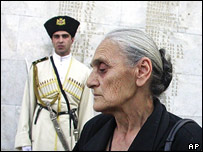 An old Georgian woman cries at a memorial to Georgians killed in the Georgian-Abkhazian conflict
