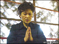 A South Korean woman prays for her children's' success in the annual college entrance examination, at Chogye Buddhist temple on November 16, 2004 in Seoul, South Korea