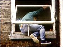 Burglar entering house