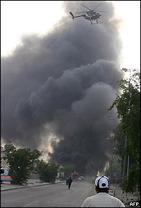 Black smoke rises after a car bomb attack on a police station on the outskirts of Baghdad's Green Zone