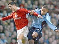Cristiano Ronaldo holds off Dexter Blackstock