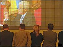 Ukraine's parliamentary speaker is seen on a large screen television inside the parliament building in Kiev