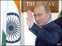 Russian President Vladimir Putin waves during his visit to India