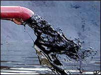 Oil gushing from a pipe at a plant in India
