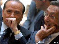 Italian Prime Minister Silvio Berlusconi (l) and cabinet member Gianfranco Fini