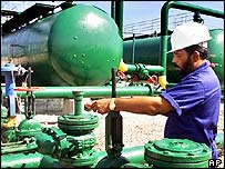 Worker in an oil plant