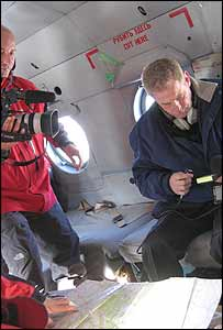 OSCE monitors and the BBC's William Horsley (right) aboard a helicopter