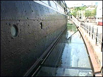 A picture of the glass platform around the hull of the SS Great Britain