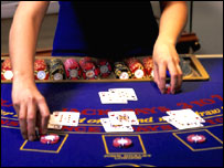 Dealer at a black jack table
