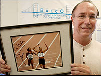 Balco founder Victor Conte holds up a signed photo from Marion Jones