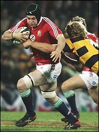 Lions number eight Michael Owen makes a burst against Taranaki
