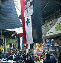 Damascus market scene with Syrian and Palestinian flags