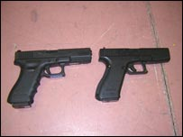 Real and replica Glock pistol