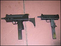 A real Ingram submachine gun and its replica cousin (right)