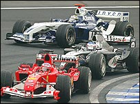 Rubens Barrichello, Kimi Raikkonen and Juan Pablo Montoya battle during the 2004 Brazilian Grand Prix