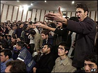 Iranian students shout slogans during speech by President Khatami