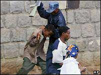 Ethiopian policeman beating students