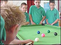 Pupils playing snooker