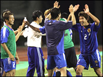 Japan celebrate qualifying for next year's World Cup in Germany