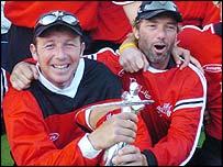 Glamorgan captain Robert Croft celebrates winning the Totesport title with Matthew Maynard