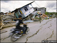 A motorcycle drives down an earthquake-hit street on March 31, 2005 on Nias, Indonesia     Getty Images