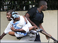 Haitian policeman during shooting in Port-au-Prince