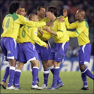 Brazil's players mob Roberto Carlos after scoring against Argentina