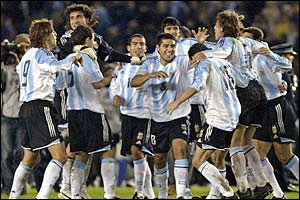 Argentina's players celebrate beating Brazil 3-1