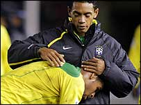 Renato consoles Adriano after Brazil's defeat in Buenos Aires