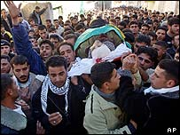 Palestinians attend the funeral of Mahmoud Kamil.