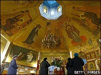 Worshippers at an Orthodox Church in Donetsk, which backs Mr Yanukovych