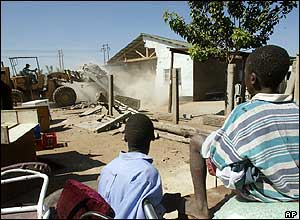 Boys watch house being demolished