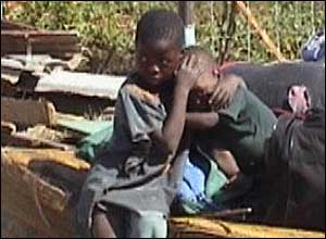 Two orphans cry after their home was demolished