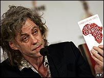 Bob Geldof with Commission for Africa report