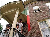 Hispanic family on steps of their house in Illinois