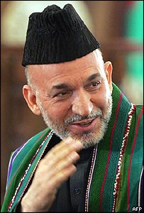 Hamid Karzai salutes after inauguration ceremony