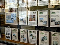 Houses for sale in estate agency window