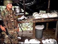 A Colombian soldier guards a haul of cocaine