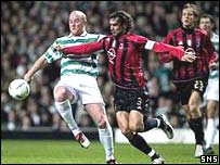 John Hartson tries to get the better of Paolo Maldini
