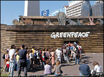 Greenpeace activists and a model of Noah's Ark in central Buenos Aires