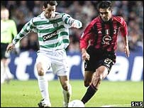Jackie McNamara tries to get away from Serginho