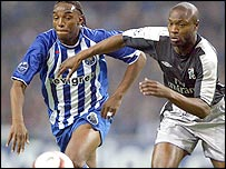 Porto striker Benni McCarthy challenges Chelsea's William Gallas