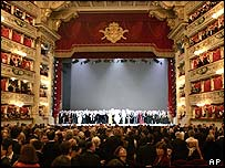 The company take applause at La Scala's re-opening