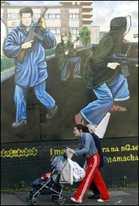 A Belfast woman walks past a republican mural