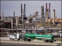 A tanker truck passes in front of Chevron refinery in California