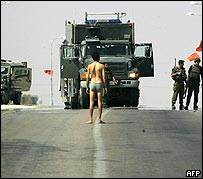 Israeli soldiers make a Palestinian taxi driver strip to look for explosives in Gaza - he was later released