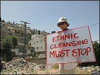 An Israeli peace activist demonstrates in the Silwan area of East Jerusalem